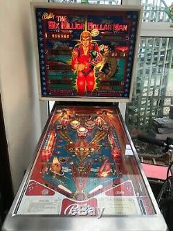 Vintage pin ball machine six million dollar man